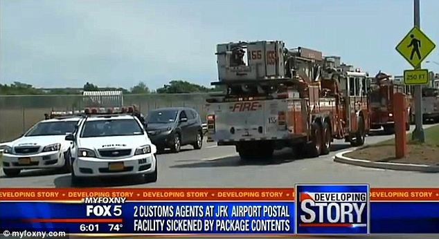 No hiccups: Operations at JFK International airport were not disrupted as authorities swarmed two facilities after the positive test for VX nerve gas