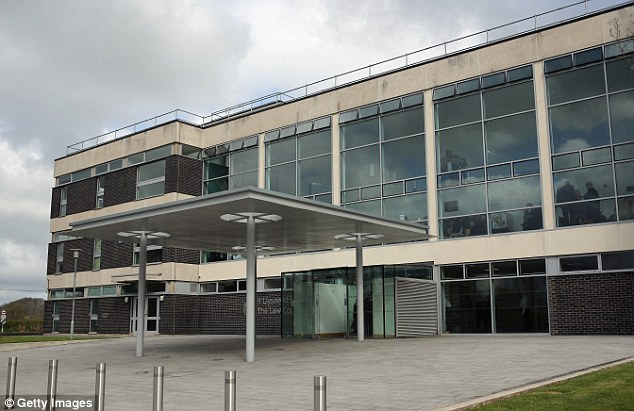 'Terrified': Staff had to fight their way into the school's computer room and pulled the 'distressed' teacher to safety after the attack, Mold Crown Court (pictured) heard