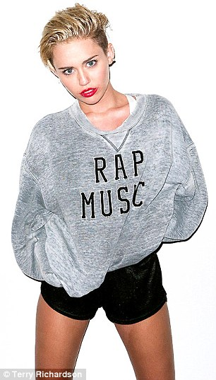 Talk about rap music: The pop star posed in another shot with a grey baggy sweater over her shorts