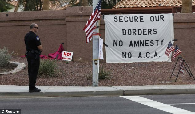 While President Obama spoke inside a Phoenix high school on August 6, angry Arizonans registered their immigration opinions outside
