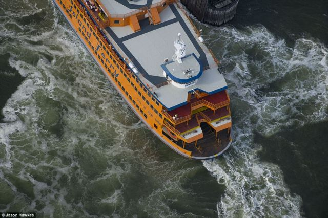 The Staten Island Ferry dutifully chugs along carrying commuters in waters below Manhattan