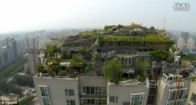 Sky high: The shots, taken by a drone, are the first look at the gigantic Beijing rooftop villa from above