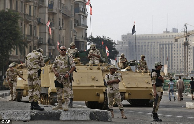 Protests: The Muslim Brotherhood has called on its supporters to gather in mosques for Friday prayers and then converge on central Ramses Square in the capital Cairo. The capital has been described as 'tense' and 'dangerous'