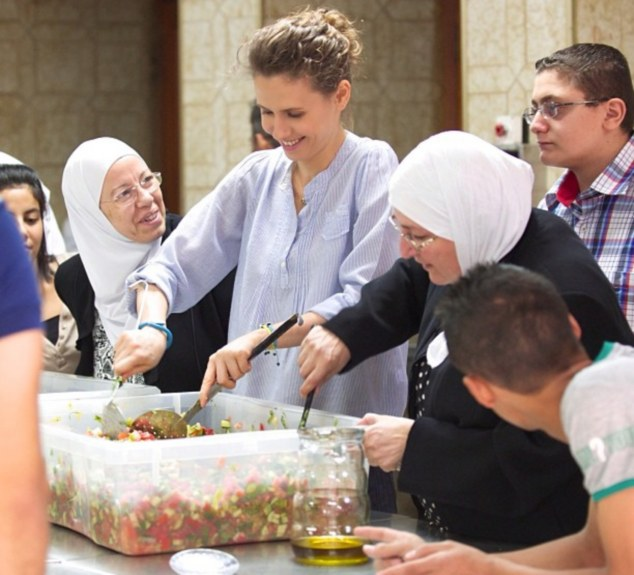Asma al-Assad posted a series of images of her day preparing the Iftar meal with volunteers from Melody of Life earlier this month