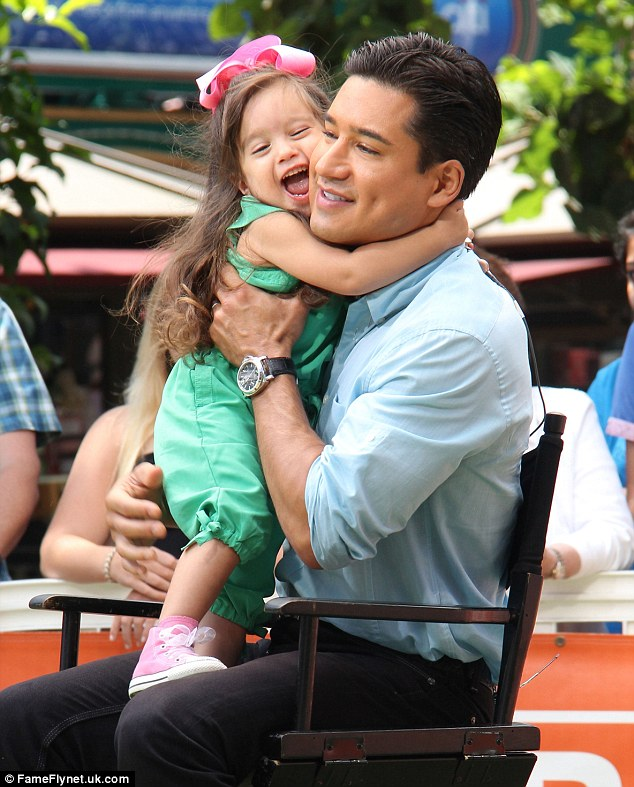 baby chair 1 year old cover express ann arbor mario lopez cuddles daughter gia as he enjoys a visit from pregnant wife courtney mazza | daily ...
