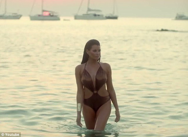 Beach babe: The 27-year-old wore a variety of skimpy ensembles