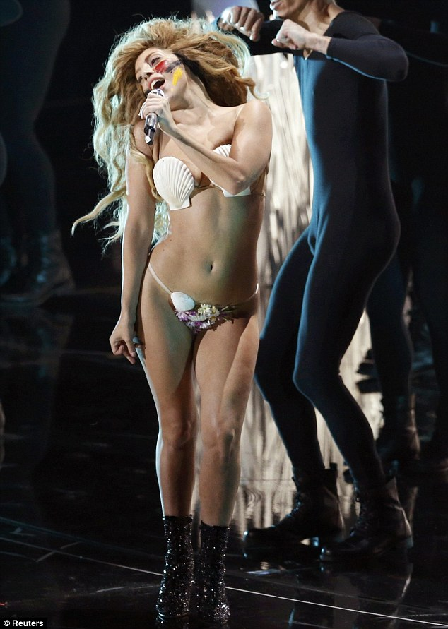 Quick change! Lady Gaga performs Applause during the 2013 MTV Video Music Awards in New York on Sunday... as she changes her outfit FOUR times