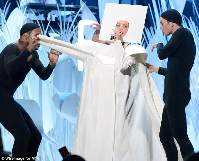 Kicking the habit: Gaga started the show dressed all in white in a nun's outfit