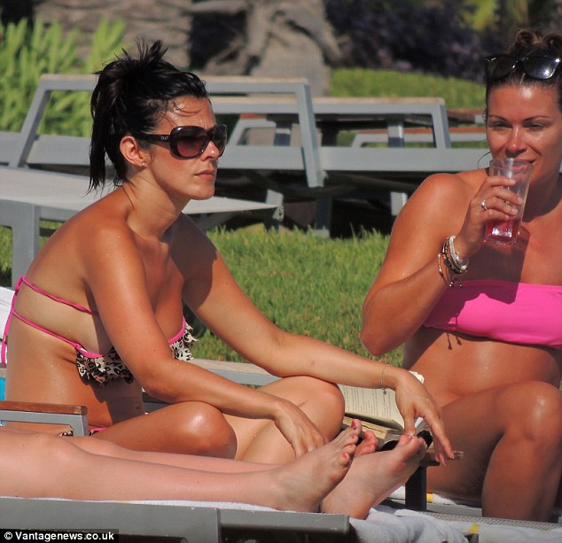 Pensive: The Corrie star looked deep in thought as she sat on a sun lounger with so-star Alison King during the break