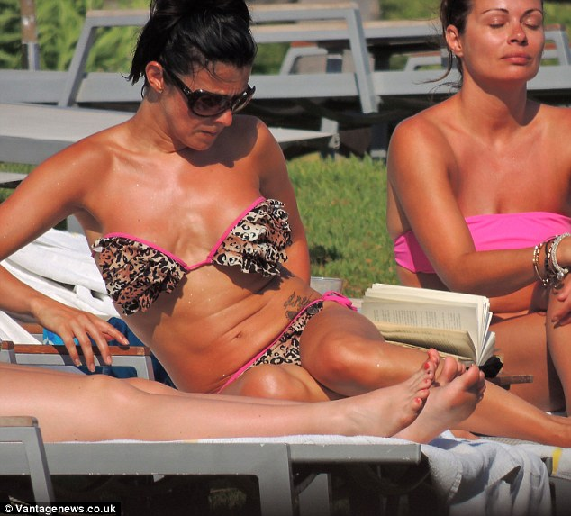 Catching rays: The star seemed keen to deepen her bronzed tan as she spent the day sunning herself