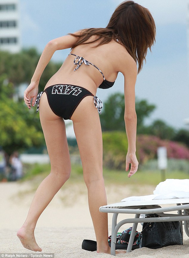 Time to chill out: Farrah heads over to her sunbed to relax for a while on her beach day out