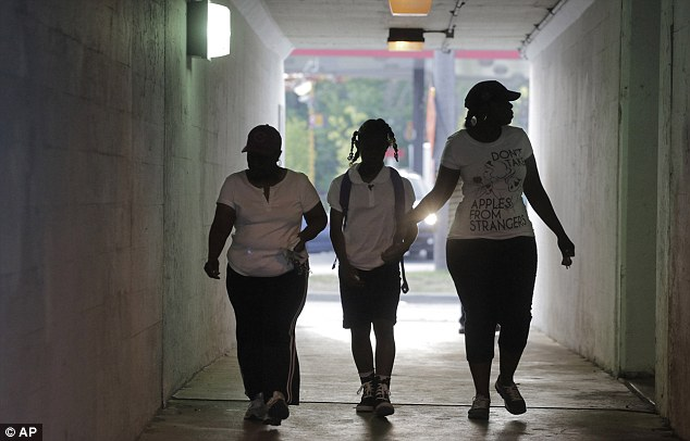 Annie Stovall, left, walks with her daughter Crystal Stoval, right, and her granddaughter Kayla Porter to Gresham Elementary School