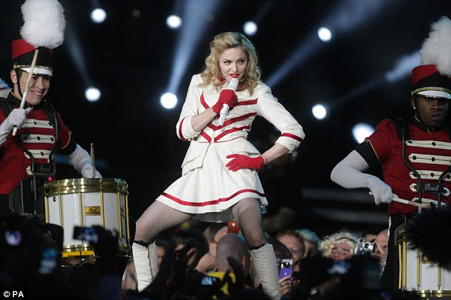Highest earner: Pop icon Madonna performs during her MDNA tour which brought in an estimated £196million ($305m)