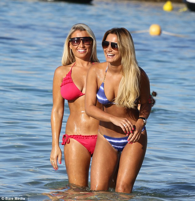 Fun in the sun: The sisters seemed happy and relaxed as they took a dip in the sea together