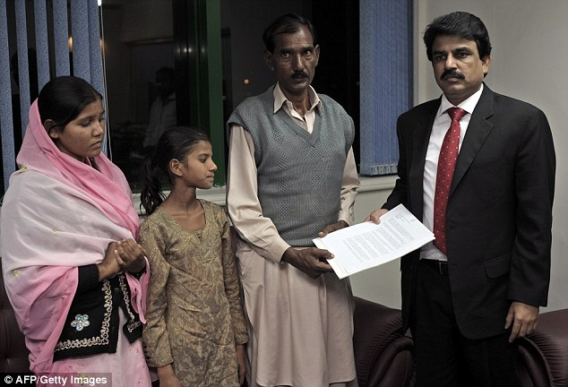 Support: Ashiq Maseeh, husband of Asia Bibi, along with his daughters Sidra, second right, and Esham, left, speak to Pakistani Minister of Minority Affairs Shahbaz Bhatti, right. He was later murdered