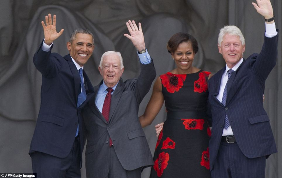 Celebration: Obama, First Lady Michelle Obama and former US Presidents Bill Clinton and Jimmy Carter wave during the Let Freedom Ring Commemoration