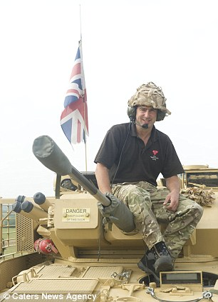 Andrew Baker with one of his tanks