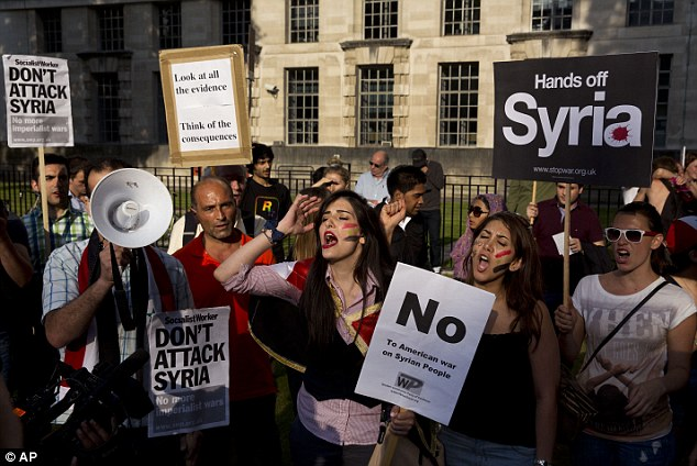 'Hands off': People take part in a protest organised by the Stop the War coalition calling for no military attack