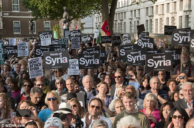 Listening: Protesters hear from Diane Abbot MP at a Stop the War Coalition demonstration at Downing Street