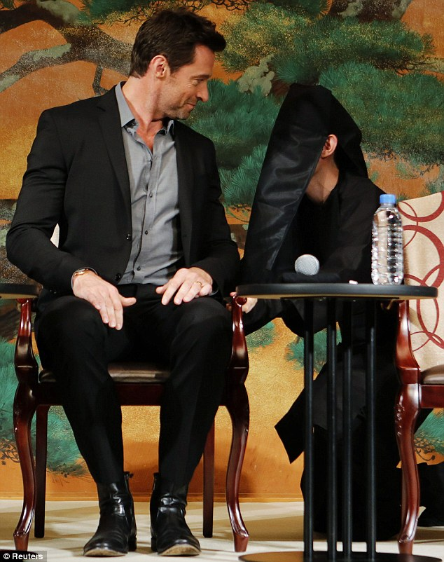 Hugh Jackman faces off with kabuki stagehand as he