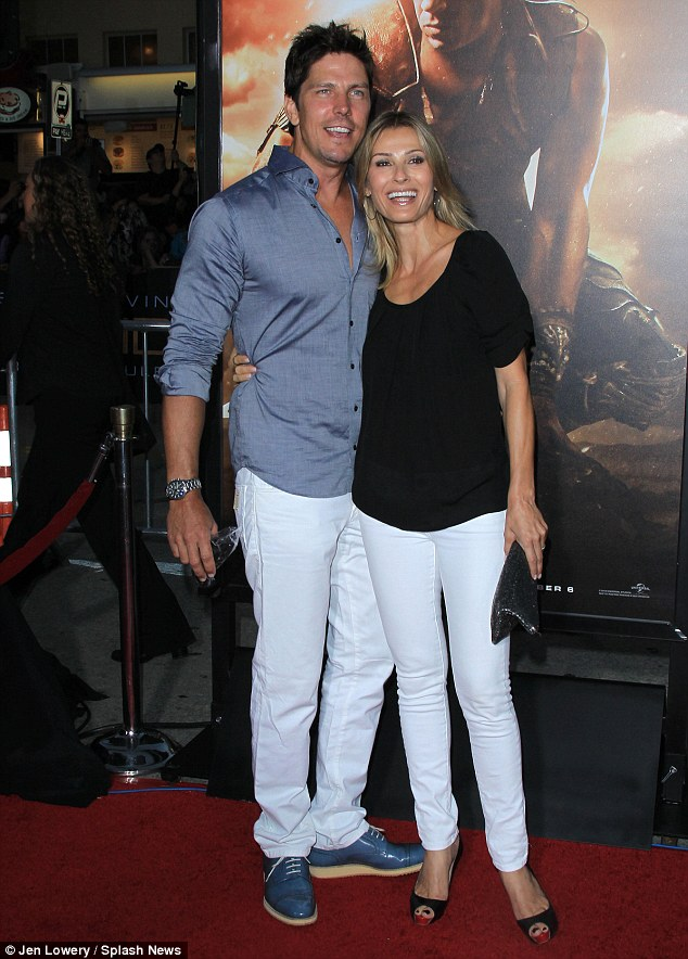 Friends reunited: Killer Woman sees Tricia starring alongside former Battlestar Galactica co-star Michael Trucco, who also attended the Riddick premiere with wife Sandra Hess