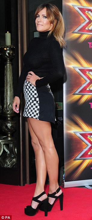 Slimmed down: Caroline Flack stunned in her checked micro mini skirt and black roll neck as she also made her way inside