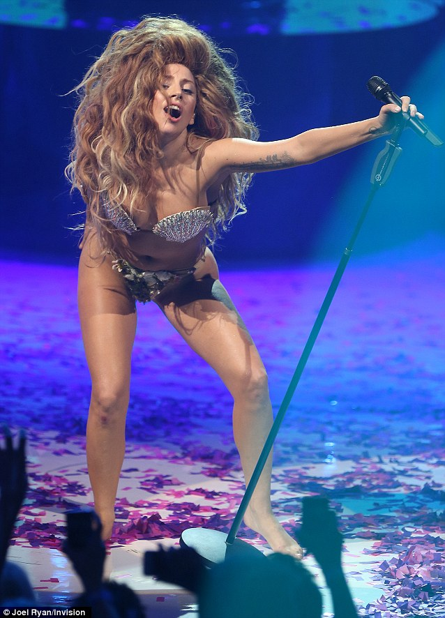 Clothes swept away? Lady Gaga performs in a shell bikini and seaweed thong at The Roundhouse, Camden