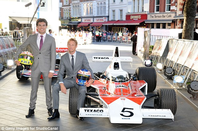 Bit of a difference! Sergio Perez (left) and Jenson Button (right) pose next to a 1976 Formula One car