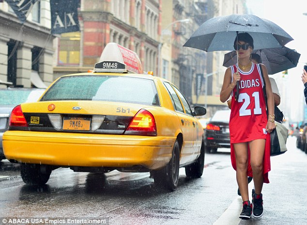 Quintessential New York: Rihanna was seen walking alongside a yellow taxicab as passersby snapped pictures