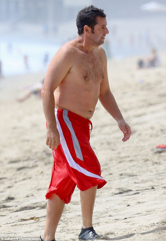 Feeling comfortable: The actor looked in good spirits as he strode towards his towel