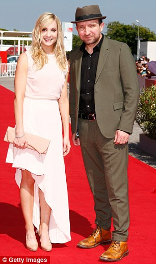 Joanne Froggatt and co-star Eddie Marsan hit the red carpet at the premiere of Still Life (left) and attending a photo-call for the new film at the 70th International Venice Film Festival (right)