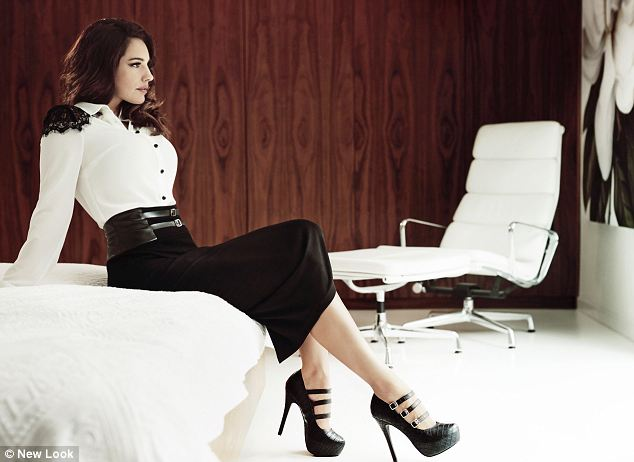 New Look says: 'Whether battling for boardroom domination or merely ordering cosmopolitans in a cocktail bar, thanks to Kelly Brook any woman can look sophisticated, sleek and super-chic this season.'