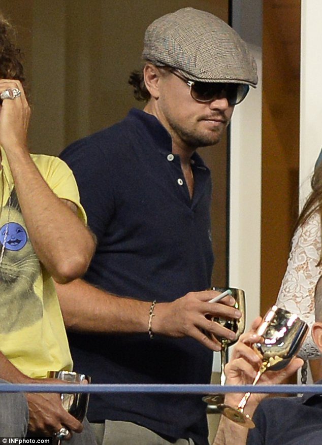 Tough life: While the athletes worked hard on the court, Leonardo was happy to sit back and relax as he drank from a gold goblet and enjoyed a cigarette