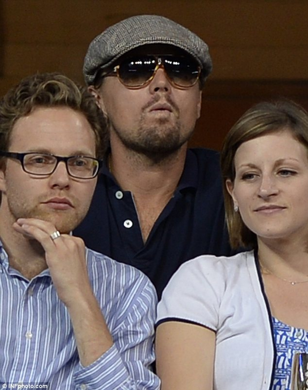 Serious: Although Serena Williams sailed to victory, Leonardo looked tense as he took in the action on the court