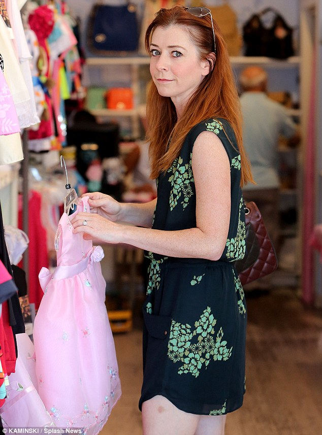 Daughter shopping: Alyson perused pink dresses for her eldest daughter Satyana