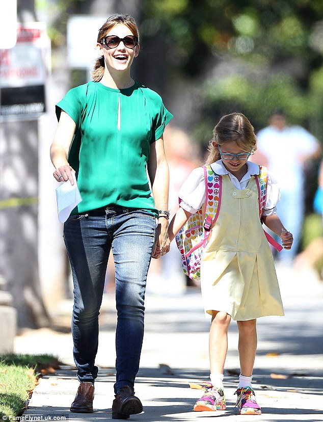 Girly time: Jennifer Garner, meanwhile, was seen picking daughter Violet up from school in Santa Monica, CA that afternoon
