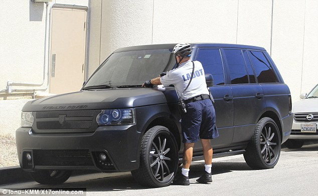 Naughty: A traffic warden was seen placing a parking ticket on Lil Twist's car