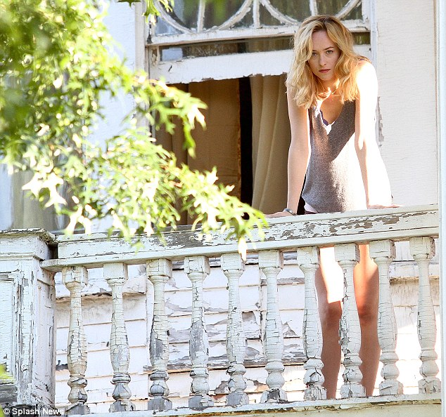 Where for art thou? Dakota was seen standing out on the balcony in her barely-there attire