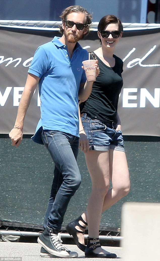 Just chilling: Anne wore a big smile while Adam sipped an iced coffee during their sunny outing