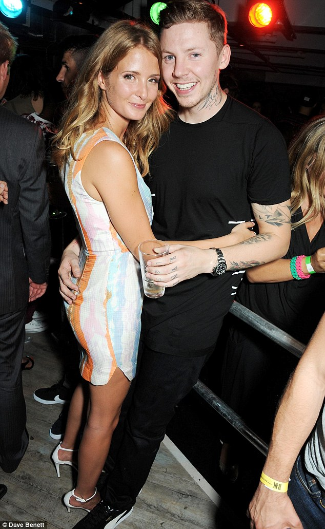 Supporting her man: Millie Mackintosh cuddles up to fiance Professor Green as he opens his brand new nightclub, INK in the West End of London on Wednesday night