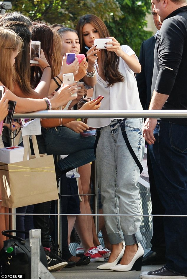 Nice nails: Gomez's sharp manicure stood out from the white off her phone