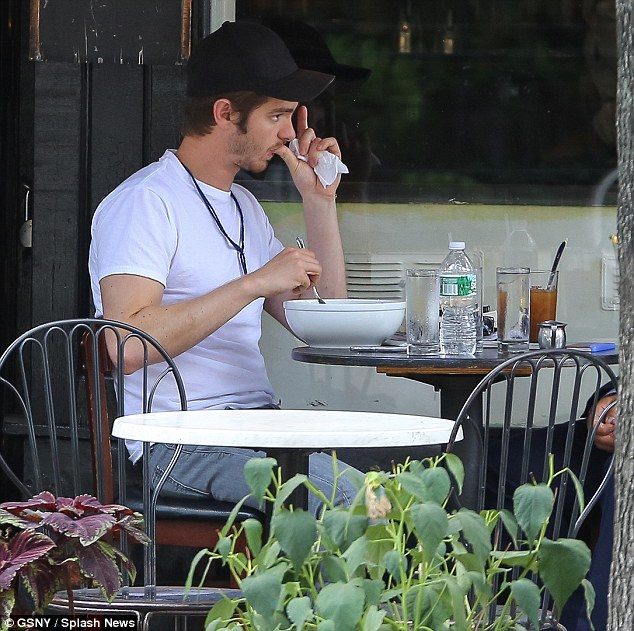 Time out: Andrew looked like he was making the most of one of his days off by dining al fresco