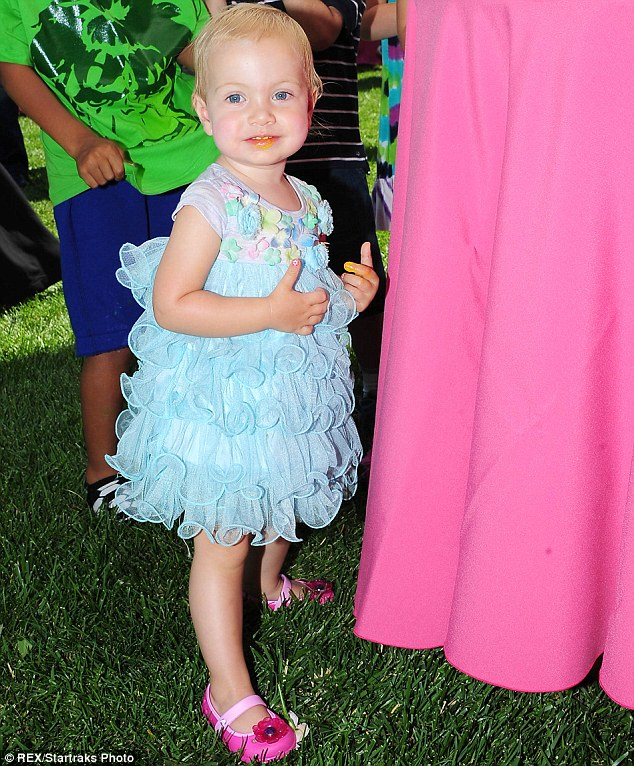 Dressed to impress: Hattie looked adorable for the party in a ruffled blue dress and pink shoes