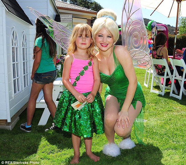 Biggest fan: Tori and Dean had even hired Tinkerbell to make a special appearance at the bash
