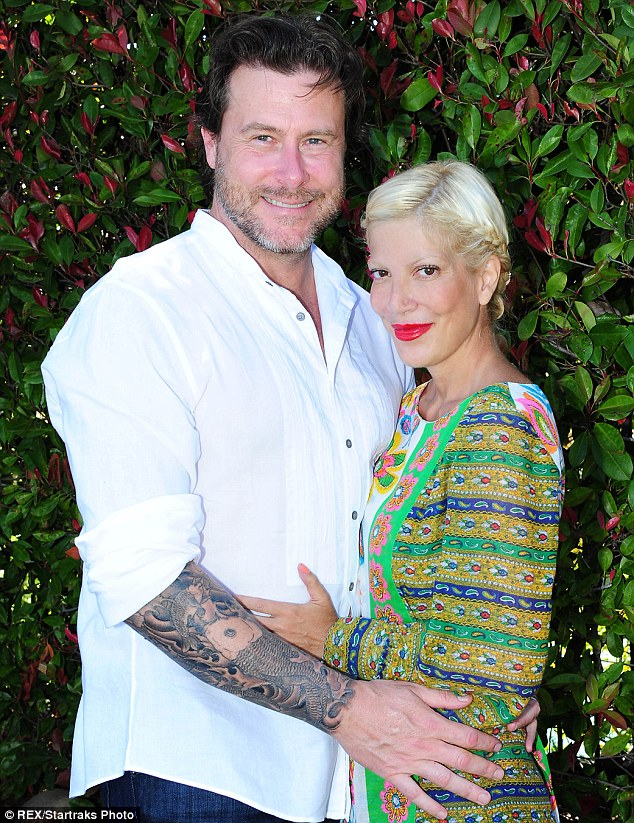 Stylish pair: Tori looked amazing in a multi-coloured dress, while Dean wore a white shirt rolled up to show off his tattoos