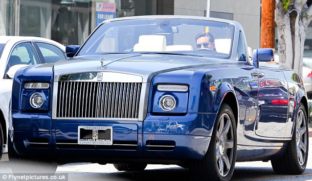 All about the brights: Scott also owns a blue Rolls Royce