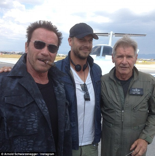 Roll call! Arnie posted another happy snap alongside Harrison Ford from the Bulgarian set where he sucked on a cigar