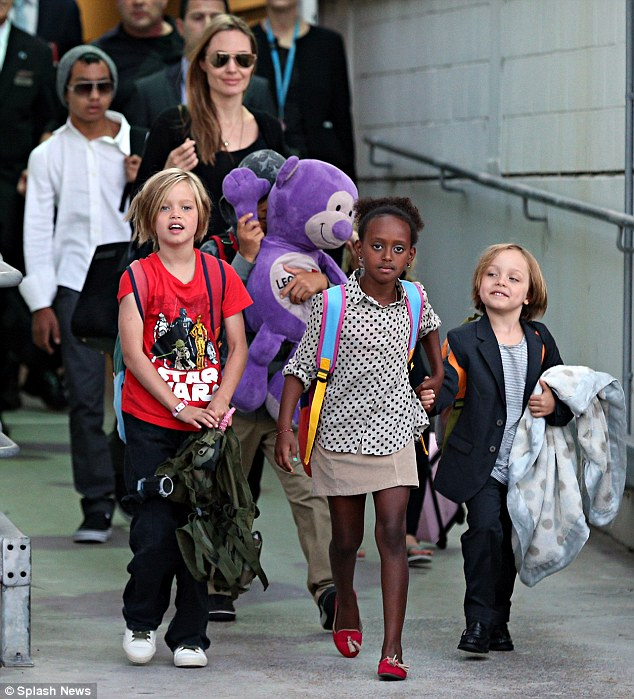 Touch down in the land Down Under! Angelina Jolie was flanked by his six-strong brood as they landed in Sydney, Australia on Thursday