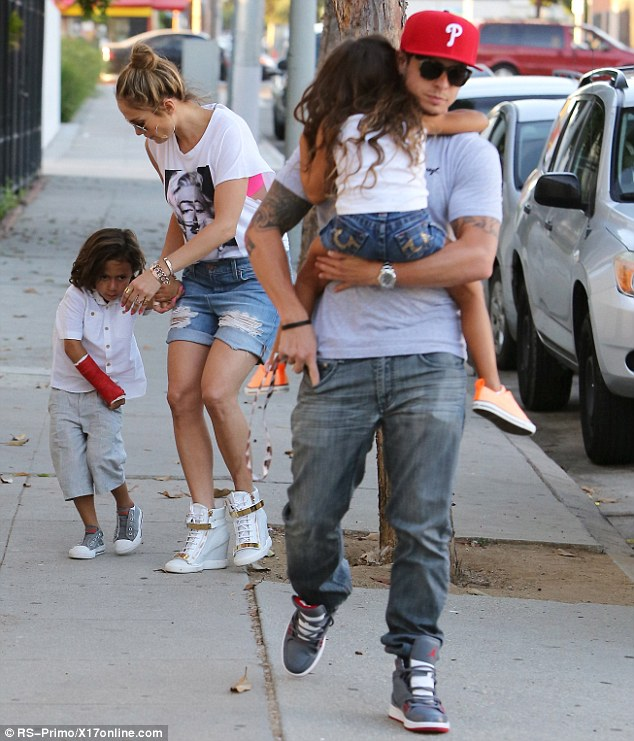 Switcheroo: Earlier in the day, Casper was seen carrying Emme while Jenifer looked after Max