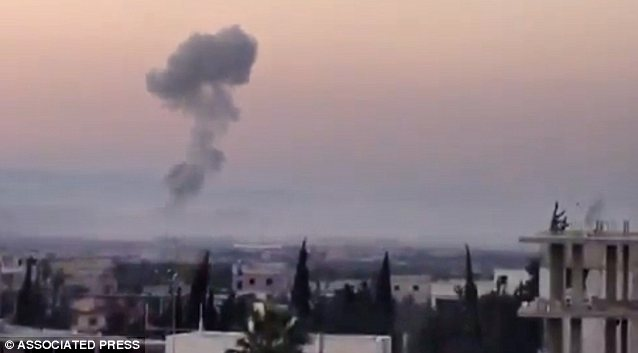 The video, authenticated based on its contents and other AP reporting, showed smoke rising from bombardments and clashes between Free Syrian army fighters and government forces in the town of Binnish